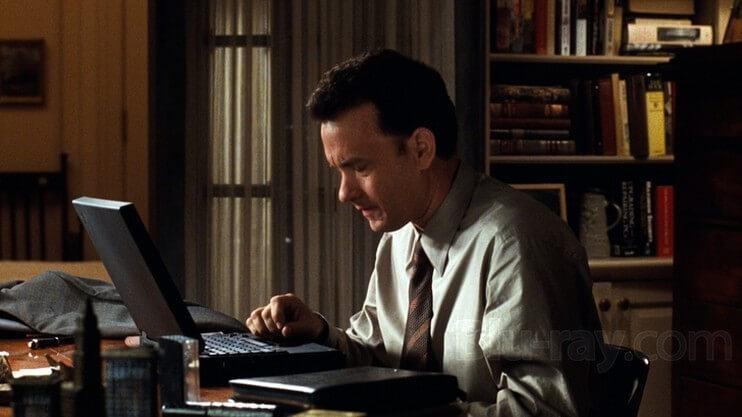 Tom Hanks escreve um e-mail para Meg Ryan.