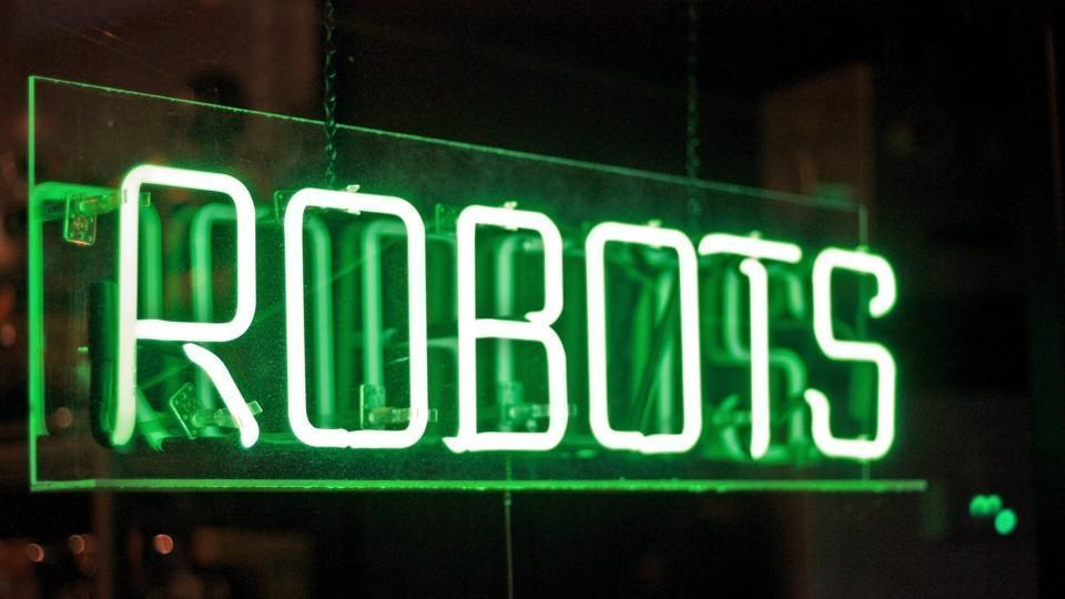 Letreiro brilhante escrito Robots.