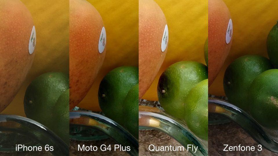 Detalhe de cesta de frutas pelas lentes de quatro smartphones.