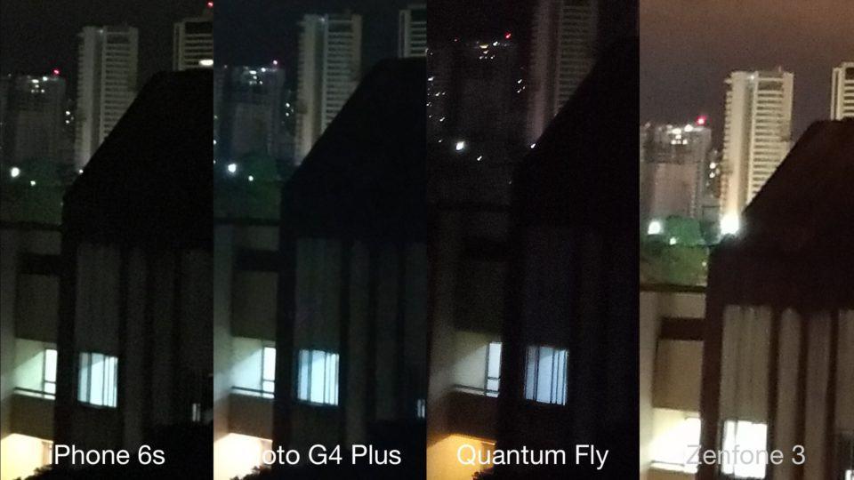 Prédios à noite pelas lentes de quatro smartphones.