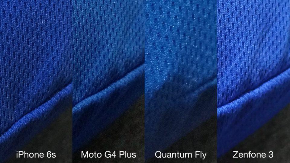 Detalhe de textura de almofada pelas lentes de quatro smartphones.