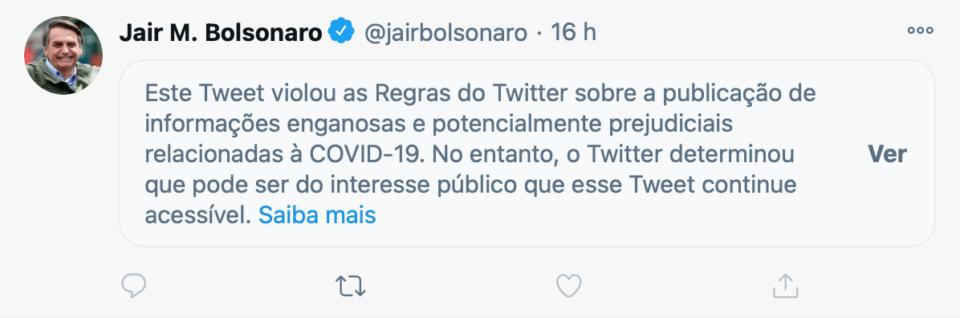 Print do post de Bolsonaro, com um aviso do Twitter informando que ele viola regras da plataforma sobre desinformação relacionada à COVID-19.